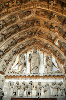 "South Porch, left Portal, Tympanum- General View.This portal is dedicated to the Confessors. Cathedral of Chartres, France. The tympanum, lintel and lower archivolts contain depictions of episodes in the martyrdom of Stephen. Christ between two kneeling angels. This is usually identified as the vision that Stephen saw during his martyrdom. Stephen saw Christ ""standing at the right hand of God"", and in this depiction, Christ is standing. .Lintel: Stephen led to his martyrdom (left) and the Stoning of Stephen (right). Archivolts: .Lowest register - More incidents in the Martyrdom of Stephen. A UNESCO World Heritage Site. .."