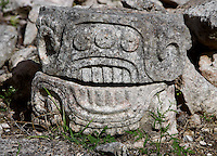"Carved, bas-relief glyph, western façade of the Codz Poop (""Rolled-up matting"" in Maya), Puuc Architecture, 700 ? 900 AD, Kabah, Yucatan, Mexico. Picture by Manuel Cohen"