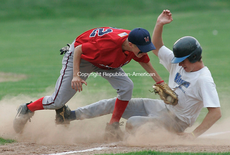 WATERTOWN, CT -22 July 2005- 072205BZ06- Bridgeport #18, Dan West slides safely into third as Wolcott #22, Dave Antonucci tries unsuccessfully to make the tag during the championship round of the Mickey Mantle Tournament Friday evening. A passed ball scored a run and advanced West to third.<br /> Jamison C. Bazinet photo