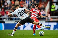 9th November 2019; Mestalla, Valencia, Spain; La Liga Football,Valencia versus Granada; Carlos Neva of Granada passes the ball across Ferran Torres of Valencia CF - Editorial Use