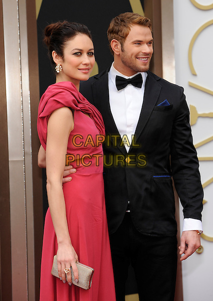 HOLLYWOOD, CA - MARCH 2: Olga Kurylenko, Kellan Lutz arriving to the 2014 Oscars at the Hollywood and Highland Center in Hollywood, California. March 2, 2014.  <br /> CAP/MPI/mpi99<br /> &copy;mpi99/MediaPunch/Capital Pictures