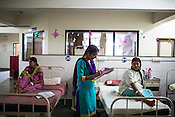 Dr. Cynthia Sharon takes down reports after speaking to a pregnant woman at the maternity ward of the Duncan Hospital in Raxaul, Bihar, India.