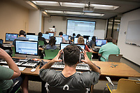 Classroom photo of Music 148, Music Production taught by Daniel Wohl in the Academic Commons oMac Lab, Nov. 8, 2017. Students use the library's computer lab and all the audio equipment to create music.<br />