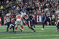 FOXBORO, MA - OCTOBER 10: New England Patriots Defensive End John Simon (55) intercepts a deflected pass during a game between New York Giants and New England Patriots at Gillettes on October 10, 2019 in Foxboro, Massachusetts.