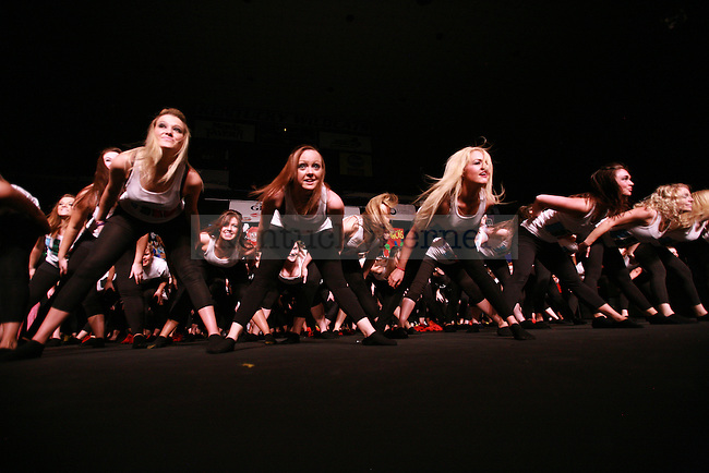 Kappa Delta sorority sisters bow in unison during their performance at the 2011 Greek Sing competition at Memorial Coliseum, Feb. 5, 2011. Photo by Kirsten Holliday | Staff