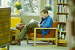 Teen aged boy studying in library