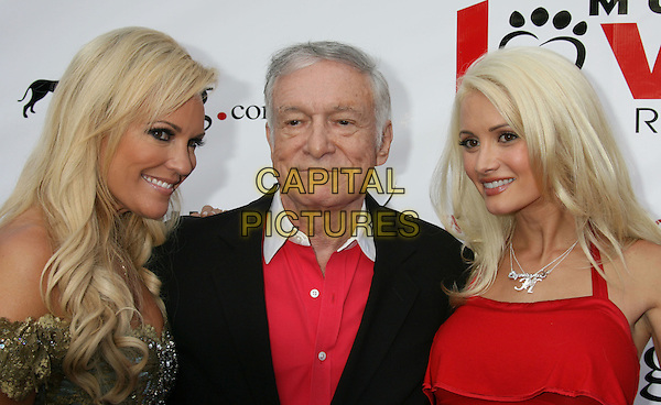 BRIDGET MARDQUARDT, HUGH HEFNER & HOLLY MADISON.2nd Annual Bow Wow Wow! Charity Event held at the Playboy Mansion, Holmby Hills, California, USA..July 19th, 2008.headshot portrait red shirt couple .CAP/ADM/MJ.©Michael Jade/AdMedia/Capital Pictures.