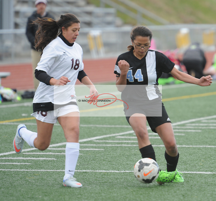 Chugiak's Mikaelyn Gogues dribbles the ball in front of  her Dimond opponent in the second half of their JV soccer contest Tuesday, April 26 at Dimond.  Photo for the Star by Michael Dinneen