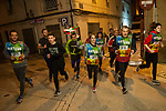 "People run on the 20th Korrika. Arketas (Basque Country). April 1, 2017. The ""Korrika"" is a relay course, with a wooden baton that passes from hand to hand without interruption, organised every two years in a bid to promote the basque language. The Korrika runs over 11 days and 10 nights, crossing many Basque villages and cities. This year was the 20th edition and run more than 2500 Kilometres. Some people consider it an honour to carry the baton with the symbol of the Basques, ""buying"" kilometres to support Basque language teaching. (Gari Garaialde / Bostok Photo)"