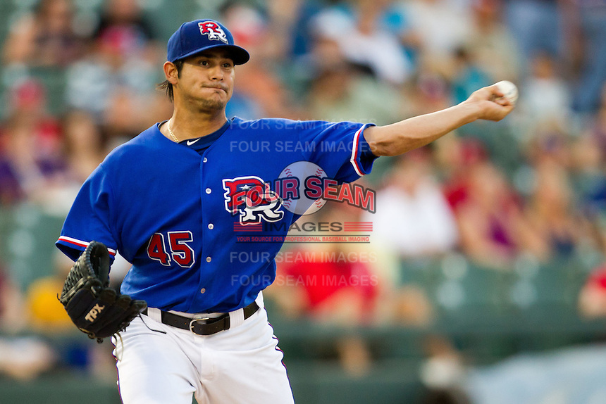 Round Rock Express pitcher Martin Perez #45 attempts a pickoff during the Pacific Coast League baseball game against the Oklahoma City RedHawks on June 15, 2012 at the Dell Diamond in Round Rock, Texas. Perez pitched seven one hit innings as the Express shutout the RedHawks 2-1. (Andrew Woolley/Four Seam Images).
