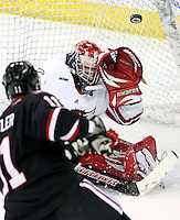 Nebraska-Omaha goalie John Faulkner is able to steer wide a shot by St. Cloud State's Jared Festler during the first period. UNO beat St. Cloud State 3-0 Friday night at Qwest Center Omaha.  (Photo by Michelle Bishop)