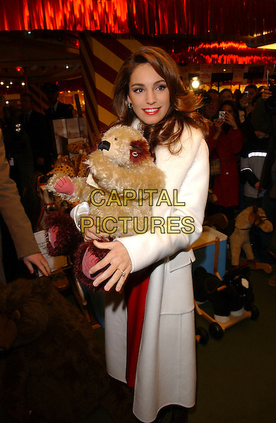 KELLY BROOK .open Harrods Winter Sale.Knightsbridge, London 28 December 2005.Ref:FIN.holding toy animal bear.www.capitalpictures.com.sales@capitalpictures.com.© Capital Pictures.