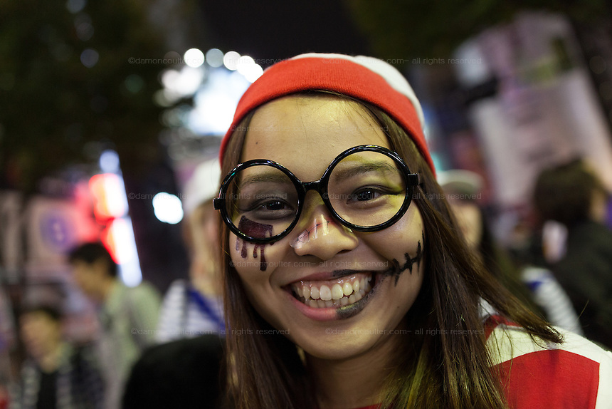 Portrait of a young Japanese reveller dressed as Waldo  in the Halloween celebrations in Shibuya, Tokyo, Japan. Saturday October 29th 2016 Halloween celebration in Japan have grown massively in the last few years. To ensure the safety of the crowds in Shibuya this year, the police closed several roads leading to the famous Hachiko Square, allowing costumed revellers to spread over a larger area.