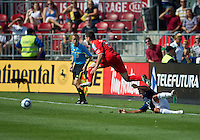 07 August 2010: Chivas USA defender Ante Jazic #6 slide tackles Toronto FC defender Dan Gargan #8  during a game between Chivas USA and Toronto FC at BMO Field in Toronto..Toronto FC won 2-1.
