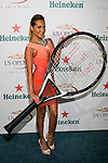 Adrienne Bailon holds an oversized tennis racket at the US Open Player Party at The Empire Hotel, August 27, 2010.