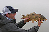Jay Zimmerman checks out a below average Carp taken in late season conditions, Out-of-Towner Flats, Somewhere on the Colorado Front Range