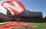 LINCOLN, NE - SEPTEMBER 21, 2013:  Tim Jorn of the Nebraska Spirit Squad waves the Nebraska flag after a touchdown during their game against South Dakota State Saturday at Memorial Stadium in Lincoln, NE.  (Photo by Dick Carlson/Inertia)
