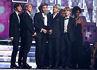 BTS presents the award for best R&B album at the 61st annual Grammy Awards on Sunday, Feb. 10, 2019, in Los Angeles. (Photo by Matt Sayles/Invision/AP)