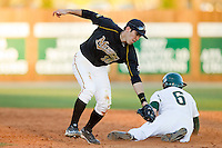 Justin Wilson #6 of the Charlotte 49ers slides into second base ahead of the tag by Eric Garcia #10 of the Missouri Tigers at Robert and Mariam Hayes Stadium on February 25, 2011 in Charlotte, North Carolina.  Photo by Brian Westerholt / Four Seam Images