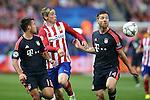 Atletico de Madrid's Fernando Torres (c) and FC Bayern Munchen's Juan Bernat (l) and Xabi Alonso during Champions League 2015/2016 Semi-Finals 1st leg match. April 27,2016. (ALTERPHOTOS/Acero)