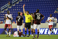 Referee Niko Bratsis gives a red card to Danny Earls (2) of the Colorado Rapids for his tackle on Sinisa Ubiparipovic (8) of the New York Red Bulls. The New York Red Bulls defeated the Colorado Rapids 3-0 during a U. S. Open qualifier match at Red Bull Arena in Harrison, NJ, on May 26, 2010.