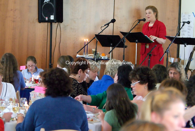 SOUTHBURY, CT- 17 APRIL 2005-041705JS04---Katie Hereld, of Cheshire, leads the Seder during the sixth annual  community-wide Women's Passover Seder Sunday at the Walzer Family Jewish Community Campus in Southbury. -- Jim Shannon Photo--Walzer Family Jewish Community Campus; Southbury; Katie Hereld; Cheshire are CQ