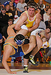 SPEARFISH, S.D. -- Leland Pfeifer of the University of Wyoming attempts a takedown against J.J. Everard during their heavyweight match Sunday at the Young Center in Spearfish, S.D.  (Photo by Richard Carlson/Inertia via dakotapress.org)