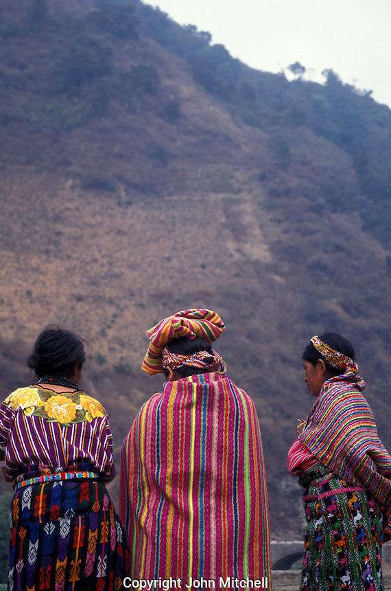 Three Maya women wearing traditional clothing or traje in the village of Zunil near Quetzaltenango