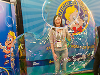 Humongous bubbles from Uncle Bubble at the 113th North American International Toy Fair in the Jacob Javits Convention center in New York on Sunday, February 14, 2016.  The four day trade show with over 1000 exhibitors connects buyers and sellers and draws tens of thousands of attendees.  The toy industry generates over $84 billion worldwide and Toy Fair is the largest toy trade show in the Western Hemisphere. (© Richard B. Levine)