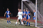 Players line up for a corner kick.