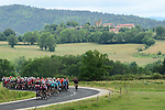 The peloton with 100km to go during another wet Stage 2 of the Criterium du Dauphine 2019, running 180km from Mauriac to Craponne-sur-Arzon, France. 9th June 2019<br /> Picture: ASO/Alex Broadway | Cyclefile<br /> All photos usage must carry mandatory copyright credit (© Cyclefile | ASO/Alex Broadway)