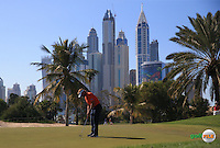 Joost Luiten (NED) holes out on the 12th green during the Final Round of the 2016 Omega Dubai Desert Classic, played on the Emirates Golf Club, Dubai, United Arab Emirates.  07/02/2016. Picture: Golffile | David Lloyd<br /> <br /> All photos usage must carry mandatory copyright credit (&copy; Golffile | David Lloyd)