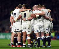 The England forwards huddle together during a break in play. Guinness Six Nations match between England and Italy on March 9, 2019 at Twickenham Stadium in London, England. Photo by: Patrick Khachfe / Onside Images