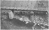 View of RGS bridge 64-A after abandonment showing concrete and wooden piers.<br /> RGS  Burns Canyon, CO  Taken by Maxwell, John W. - 8/19/1958