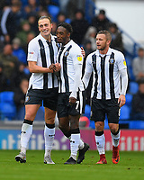Tom Eaves of Gillingham left is congratulated after scoring the first goal by Brandon Hanlan and Dean Parrett of Gillingham during Portsmouth vs Gillingham, Sky Bet EFL League 1 Football at Fratton Park on 6th October 2018