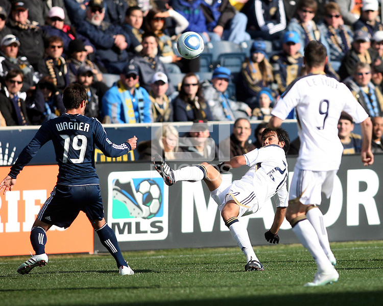 Carlos Ruiz#20 of the Philadelphia Union hooks the ball past Blake Wagner#19 of the Vancouver Whitecaps during an MLS match at PPL Park in Chester, PA. on March 26 2011. Union won 1-0.