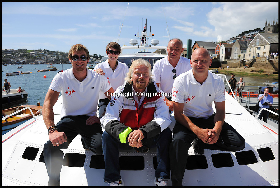BNPS.co.uk (01202 558833)<br /> Pic: VirginGroup/BNPS<br /> <br /> Branson reunited with the boat in 2014.<br /> <br /> The iconic record-breaking powerboat that helped make Sir Richard Branson a household name has emerged for sale for £725,000 after it was saved from the skip.<br /> <br /> Sir Richard shattered the world record for the fastest ever crossing of the Atlantic on the 72ft Virgin Atlantic Challenger II in 1986, two years after launching his own airline.<br /> <br /> The £1.5m boat was sold to a Middle Eastern sheik in the late 80s but then spent the next 25 years languishing in a boatyard on the Spanish holiday island of Mallorca until boat-mad Dan Stevens stumbled across it in 2012.<br /> <br /> Dan, 41, a former merchant navy officer from Plymouth, snapped it up and has since poured around 1,000 man hours and £500,000 into getting the boat up and running again, including the original purchase price