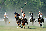 (Center) Prince Harry and Nacho Figueras (Caption of the Black Watch team) competing at the 3rd Annual Veuve Clicquot Polo Classic on Governors Island on June 27, 2010.
