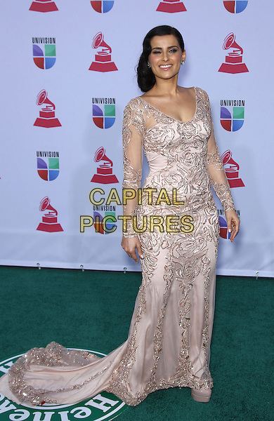 Nelly Furtado.2012 Annual Latin Grammy Awards arrivals at Mandalay Bay Resort Hotel and Casino, Las Vegas, Nevada, USA, .15th November 2012..full length cream pink nude dress long maxi train patterned silver sleeves sheer long sleeve .CAP/ADM/MJT.© MJT/AdMedia/Capital Pictures.
