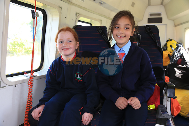 Emma Ryan and Arisha Conn Pictured during the visit of the Irish Coast Guard Helicopter from Dublin Airport with members of the Irish Coast Guard Drogheda at Whitecross national school in Julianstown Co Meath.<br /> Picture:  Fran Caffrey / www.newsfile.ie