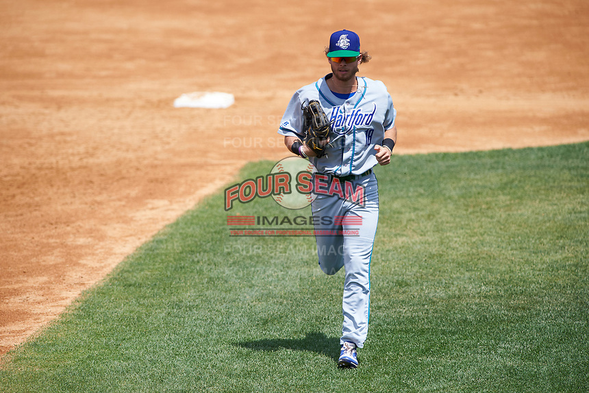 Hartford Yard Goats right fielder Max White (18) jogs to the dugout in between innings during a game against the Binghamton Rumble Ponies on July 9, 2017 at NYSEG Stadium in Binghamton, New York.  Hartford defeated Binghamton 7-3.  (Mike Janes/Four Seam Images)