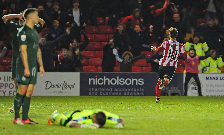 Lincoln City's Adam Marriott celebrates scoring his sides second goal <br /> <br /> Photographer Andrew Vaughan/CameraSport<br /> <br /> Vanarama National League - Lincoln City v Tranmere Rovers - Saturday 17th December 2016 - Sincil Bank - Lincoln<br /> <br /> World Copyright &copy; 2016 CameraSport. All rights reserved. 43 Linden Ave. Countesthorpe. Leicester. England. LE8 5PG - Tel: +44 (0) 116 277 4147 - admin@camerasport.com - www.camerasport.com