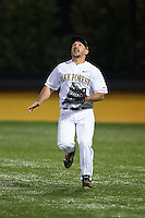 Wake Forest Demon Deacons right fielder Joey Rodriguez (8) tracks a fly ball during the game against the Georgetown Hoyas at David F. Couch Ballpark on February 19, 2016 in Winston-Salem, North Carolina.  The Demon Deacons defeated the Hoyas 3-1.  (Brian Westerholt/Four Seam Images)