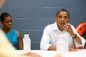 United States President Barack Obama (left) and his wife Michelle speaks with Panama City Mayor Panama City Mayor Scott Clemes during a meeting with area officials  at a Coast Guard base in Panama City, Florida USA on Saturday, 14 August  2010.  The First Family is vacationing in the area for the day.  .Credit: Dan Anderson / Pool via CNP