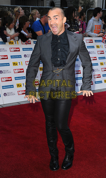 Louis Spence.'The Daily Mirror's Pride Of Britain Awards 2011' at Grosvenor House Hotel, London, England..3rd October 2011.full length black grey gray suit jacket trousers ruffle shirt mouth open hands funny .CAP/BEL.©Tom Belcher/Capital Pictures.