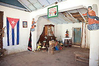 Cuba, Trinidad.  An Altar to St. Anthony, San Antonio, representing the African God Ogun, in a Room where Afro-Cuban Religious Ceremonies are Practiced.
