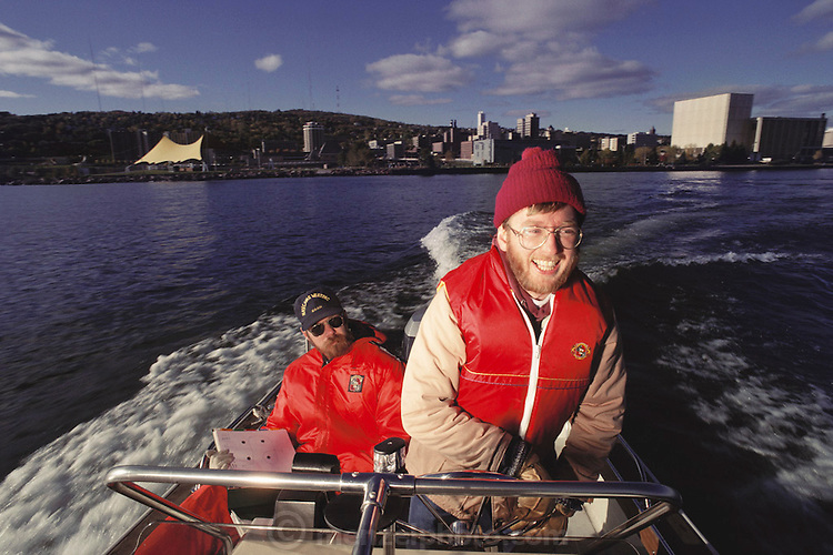 Hypothermia Research at the University of Minnesota Hypothermia laboratory in Duluth; cold, fatigue, alcohol study with motorboat drive test on Lake Superior.  The driver has been given measured amounts of alcohol and his reactions tested. MODEL RELEASED [1988]