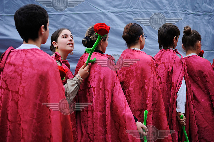 A group of young people in costume for Easter carnival, which is celebrated just before Lent.