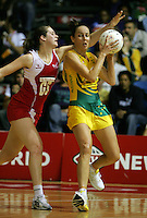 16.11.2007 Australian Liz Ellis and England's Louisa Brownfield in action during the Australia v England match at the New World Netball World Champs held at Trusts Stadium Auckland New Zealand. Mandatory Photo Credit ©Michael Bradley.