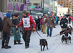 Musher Lance Mackey greets an onlooker as he leads his dog team to the ceremenial start of the 43rd Annual Iditarod in Anchorage, Alaska. The 1000 mile dog sled race usually restarts in Willow, Alaska, and finishes in Nome. Poor snowfall, however, forced the restart north to Fairbanks.